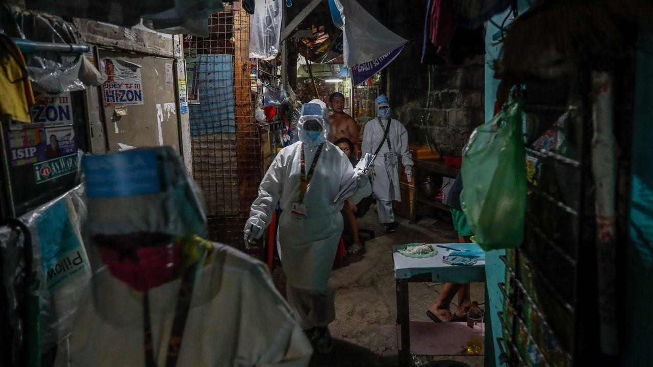 En la zona 84 de Manila los residentes llamana «astronautas» a los sanitarios que visitan a los enfermos de covid