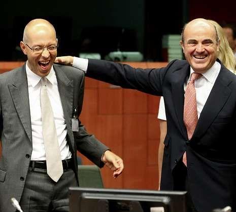 El miembro del comité ejecutivo del Banco Central Europeo, Jörg Asmussen, con De Guindos.