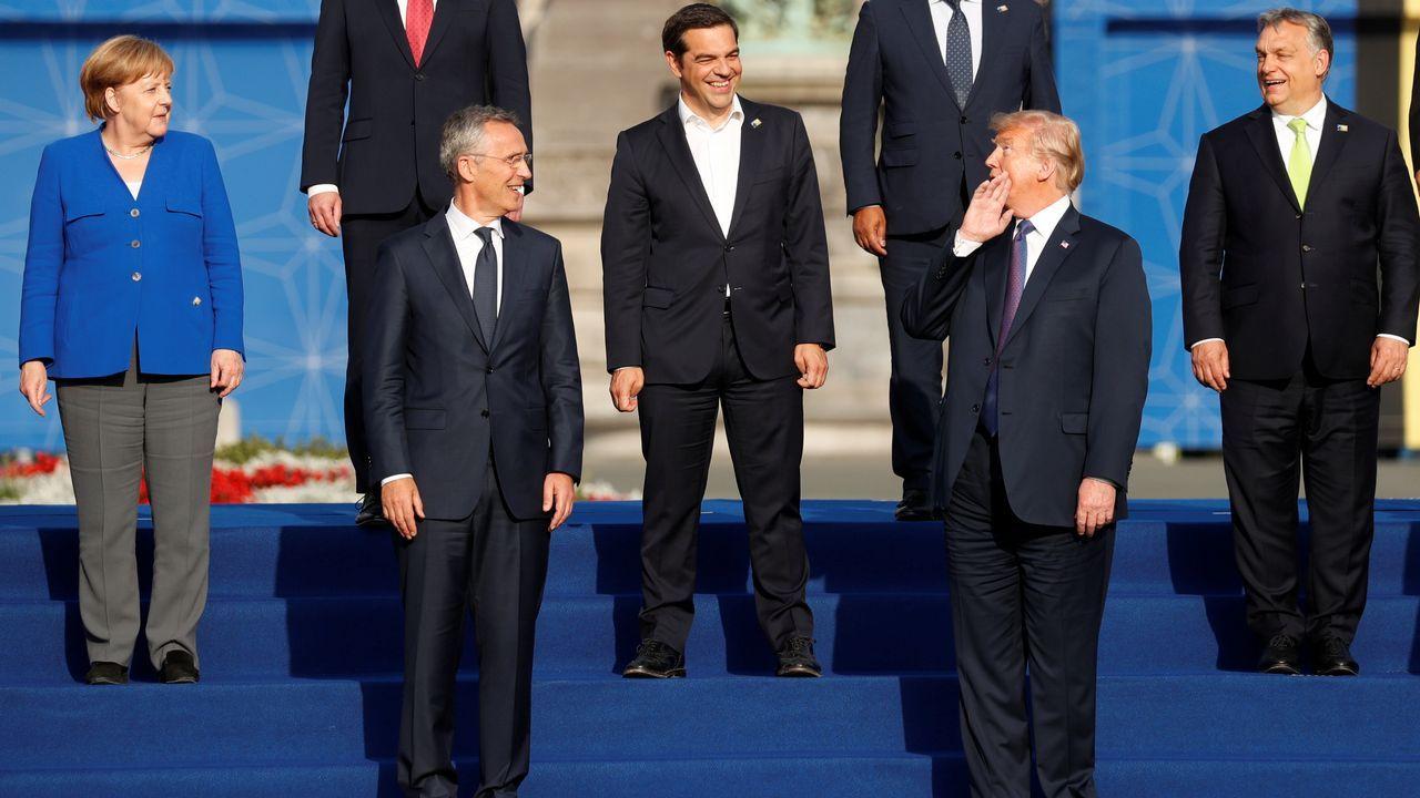 La cumbre de Trump y Putin en Helsinki, en imágenes.Trump intenta bromear con Merkel después de convertirla en la diana de su furia