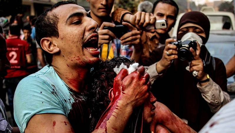 Graban a Mursi en el lugar en el que se encontraba encarcelado.El rey jordano con el presidente egipcio.