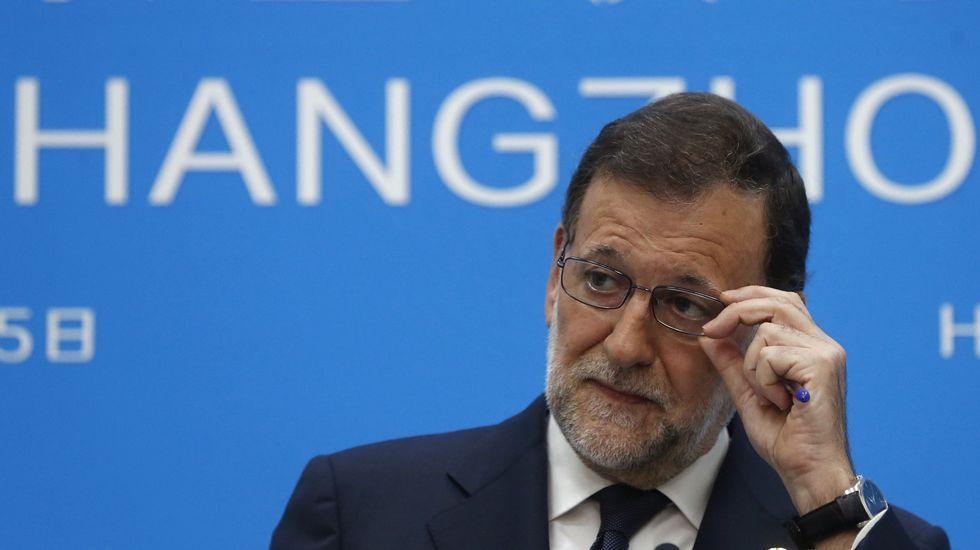 Rajoy: «El señor Soria es un funcionario que ha participado en un concurso».De Guindos y Soria, en una imagen de archivo