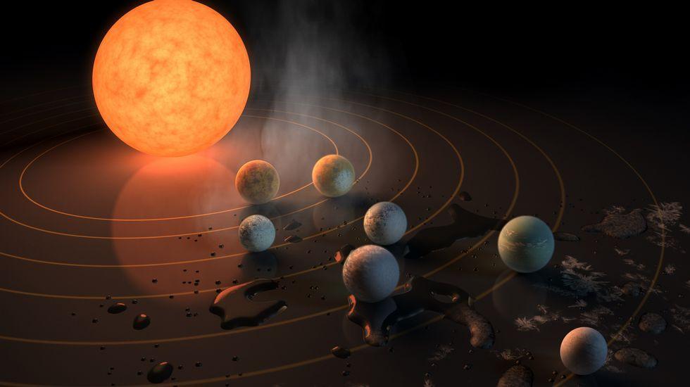 Esta impresión artística muestra Trappist-1 y sus planetas reflejados sobre una superficie.