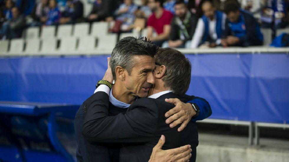 Anquela Marti Horizontal.Anquela y Marti se abrazan antes del partido