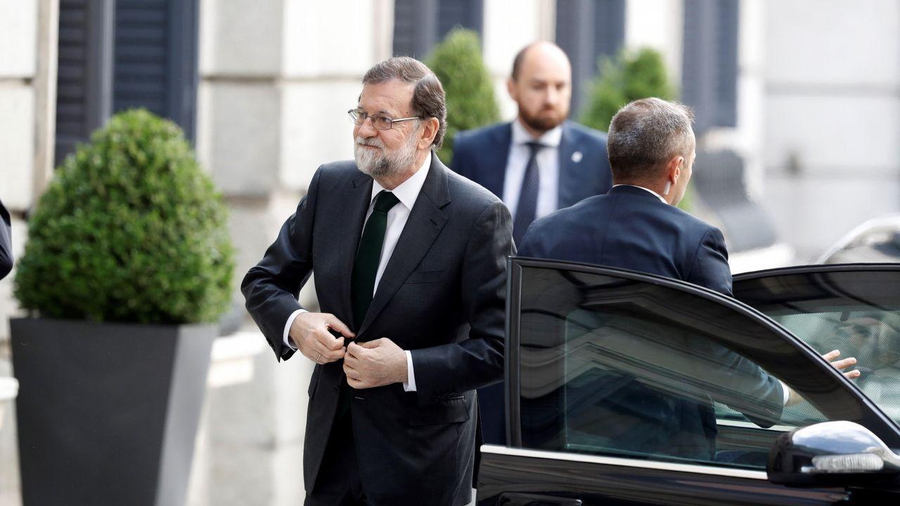 Momento en el que Mariano Rajoy llegó al Congreso de los Diputados, poco antes de las diez y media de la mañana.