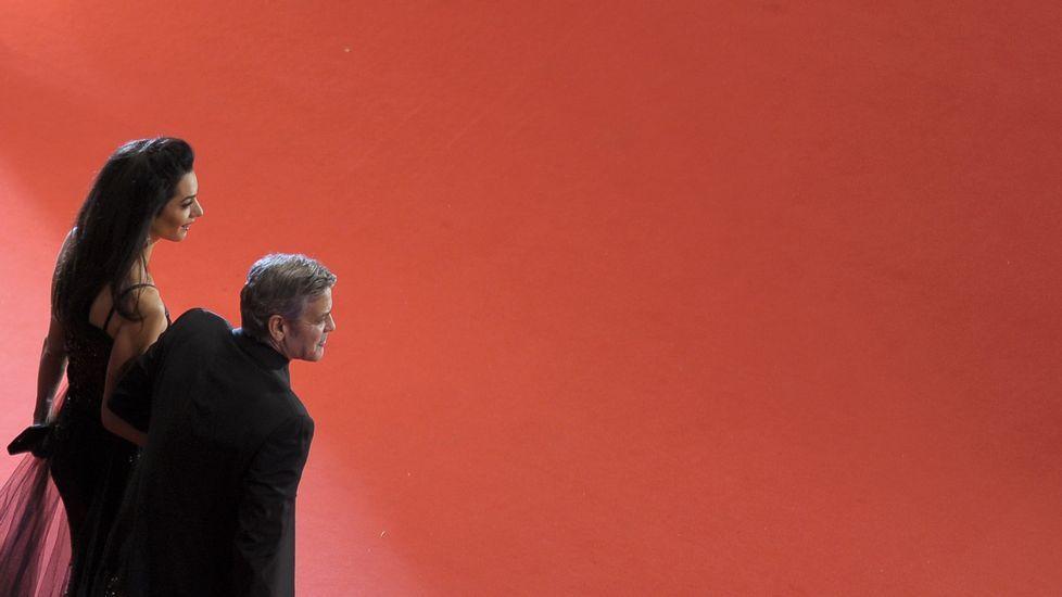 El actor estadoundiense George Clooney y su mujer Amal Clooney.