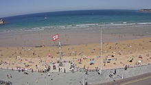La playa de San Lorenzo, en Gijón, este mediodía captada por una cámara de vigilancia