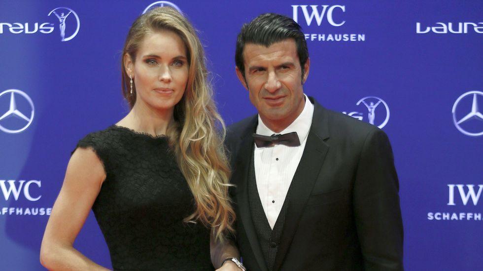 Luis Figo y su esposa.