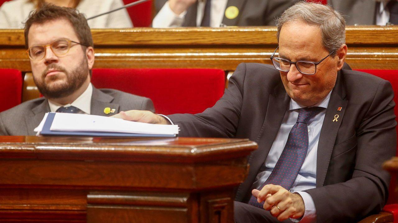 El vicepresidente Pere Aragonès (ERC y el presidente de la Generalitat, Quim Torra (JXC), este jueves, en el Parlamento de Cataluña