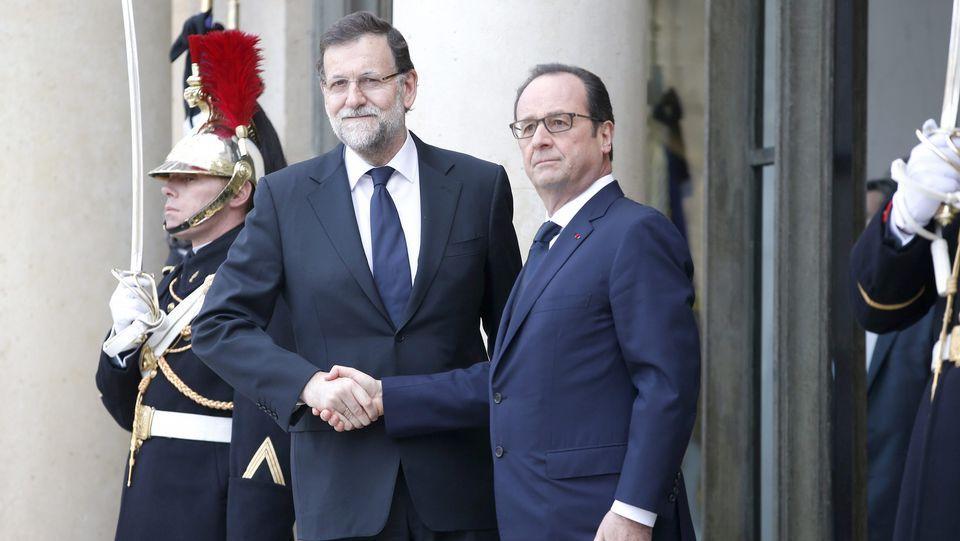 Los líderes mundiales en el Elíseo.El ministro de Finanzas griego, Yanis Varufakis