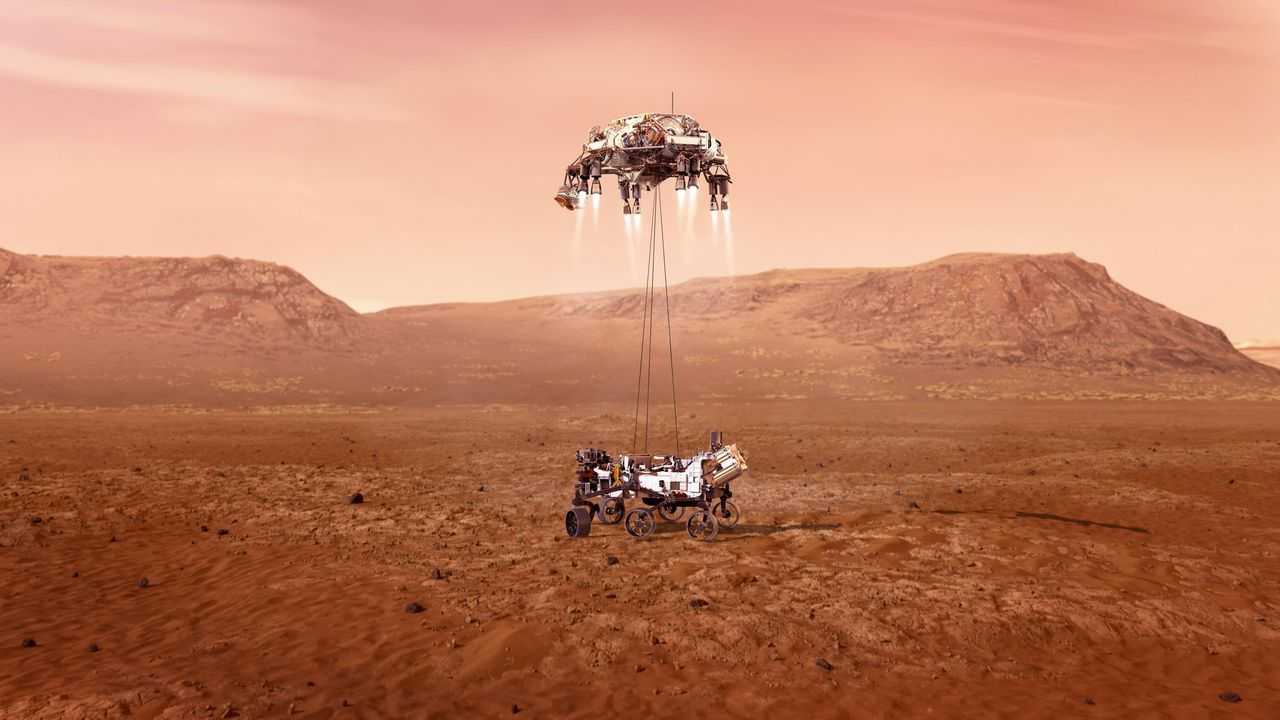 Fotografía cedida este miércoles por la Administración Nacional de Aeronáutica y el Espacio (NASA) que muestra una ilustración del rover Perseverance mientras aterriza de forma segura sobre la superficie de Marte. El viaje de casi siete meses de la Tierra a Marte de la sonda espacial Perseverance terminará este jueves con un desafiante intento de aterrizaje en el planeta rojo que nadie podrá seguir en tiempo real por la diferencia de comunicaciones de 11 minutos entre ambos planetas