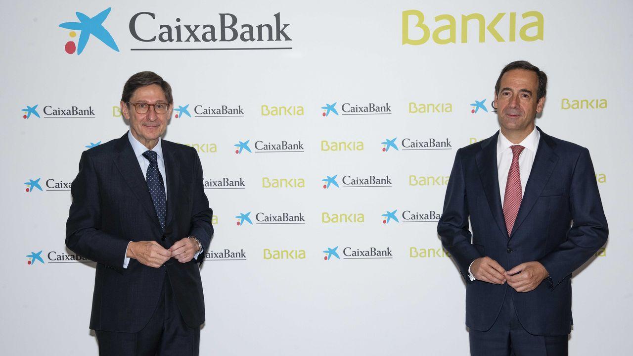 El presidente de Bankia y el consejero delegadode CaixaBank presentan el acuerdo de fusión.Duro Felguera