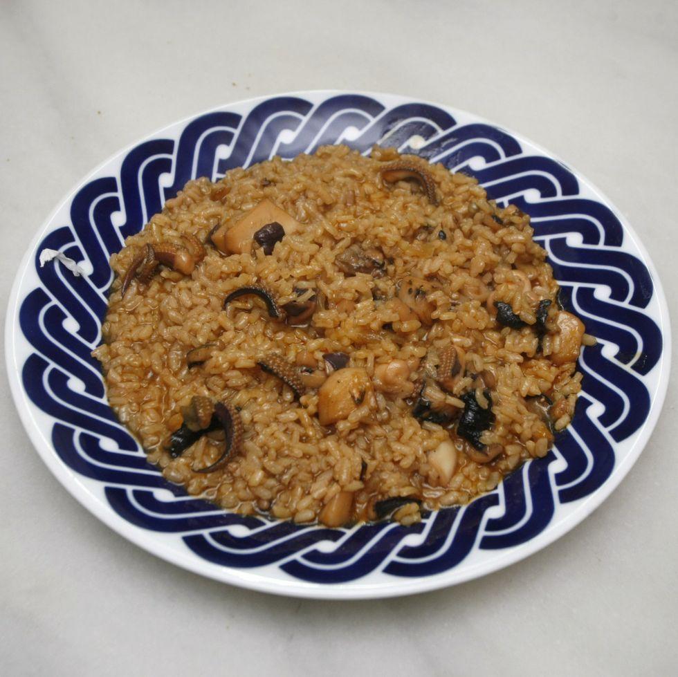 Pablo Costa preparó un arroz con jibia que pescó él mismo.