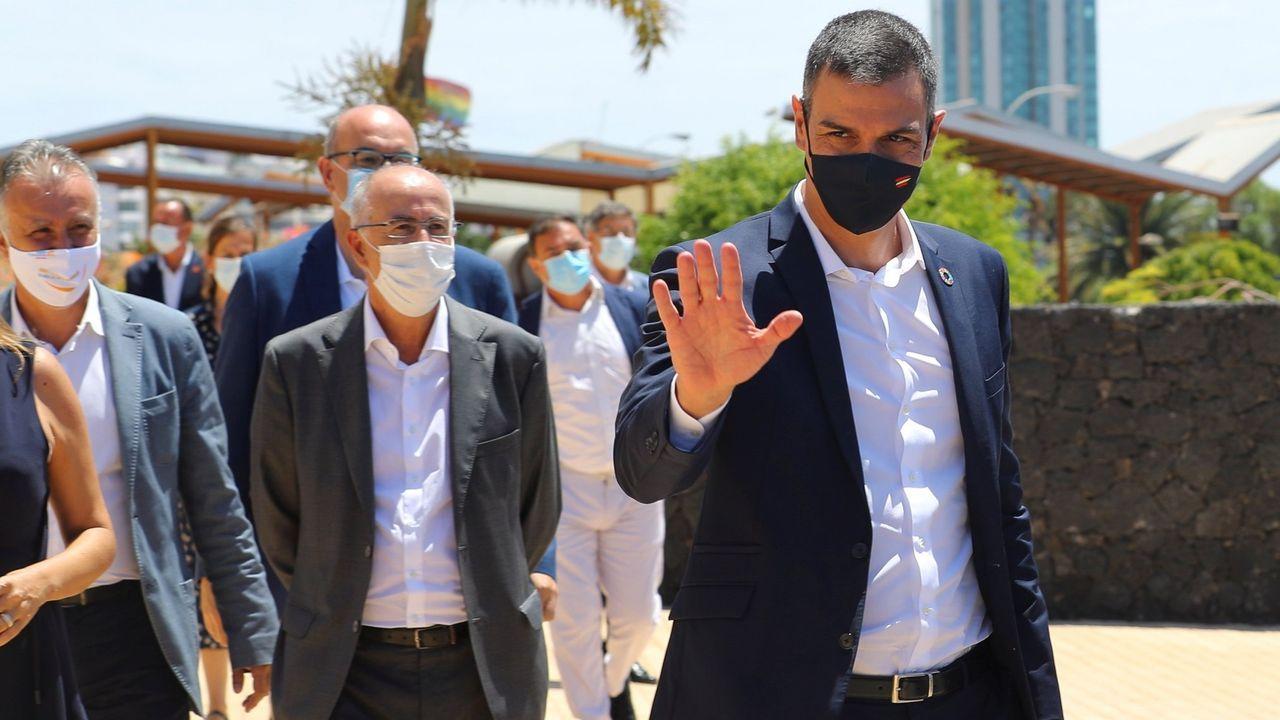 Imágenes de la pandemia en el mundo 10/08.Dos agentes de los Carabineros de Italia