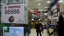 Administracion de lotería de Urzaiz, 167, que repartio parte de un quinto
