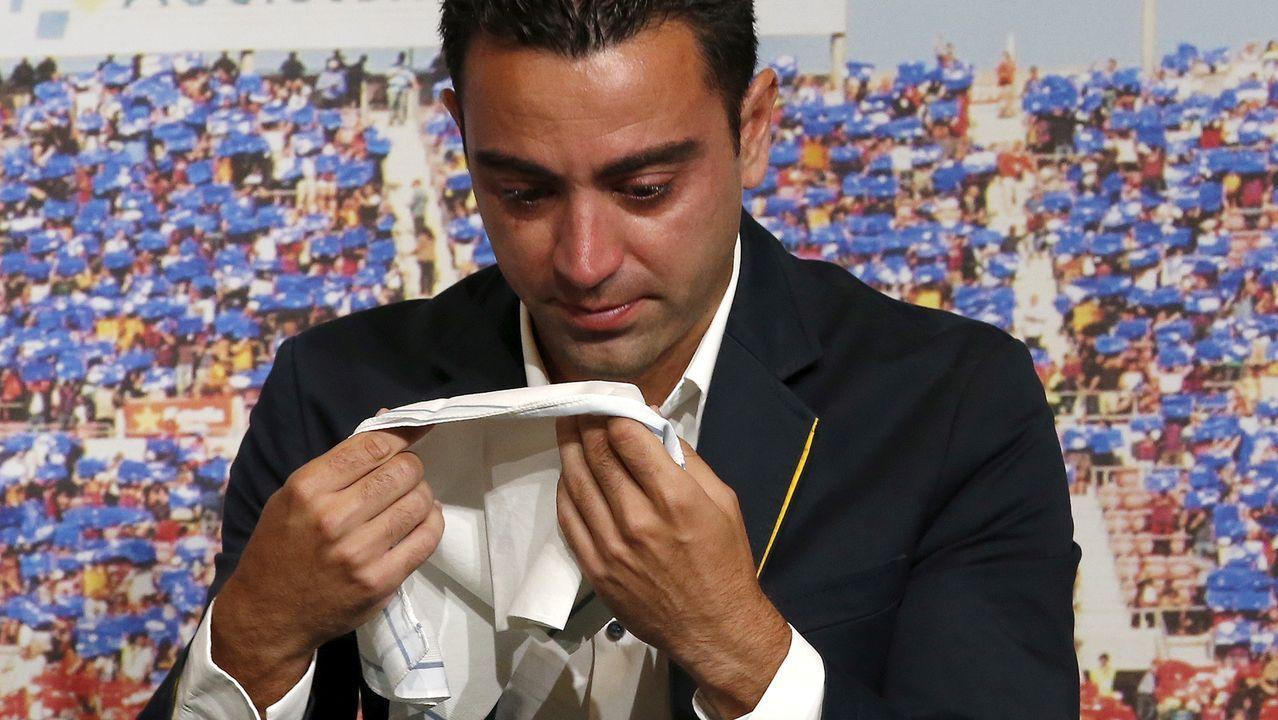 david villa.Xavi, durante su despedida como jugador del Barça