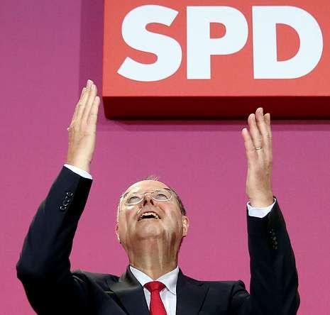 Merkel viñeta.Steinbruck, ayer en Berlín tras conocer su derrota electoral.
