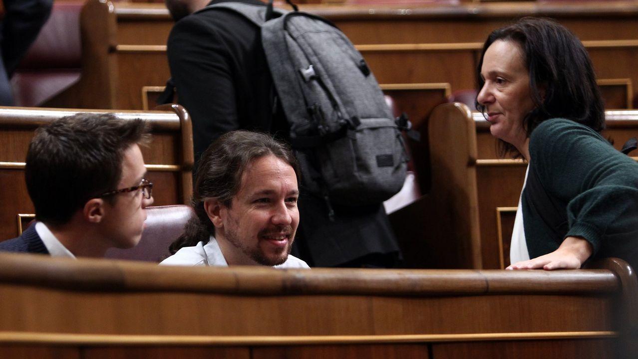 Iglesias: «¿Puede garantizar que sus candidatos son, al menos, tan limpios como usted?».Errejón, durante su vista a la Facultad de Ciencias Políticas de Santiago, donde impartió una conferencia