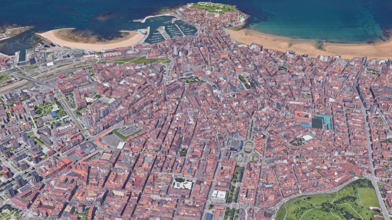 El casco urbano de Gijón, con la mancha verde de los Pericones en primer plano, a la derecha