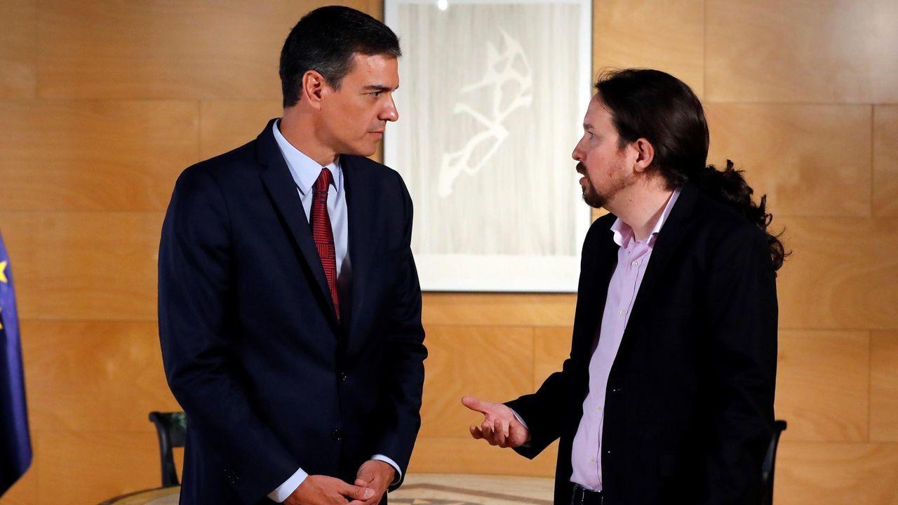 El presidente del Gobierno Pedro Sánchez (i) y el líder de Podemos Pablo Iglesias, el pasado día 9 durante la ronda de consultas para la investidura