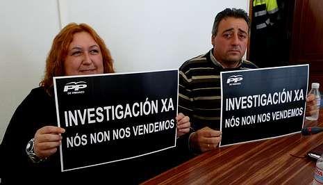 Los ediles del PP, Carmen Borbujo y Juan Amado, durante un polémico pleno por este asunto.