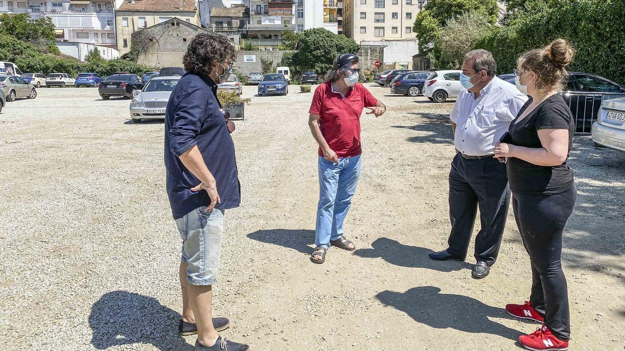Controles en la frontera con Portugal en Feces.Imagen del nuevo edicio del hospital de Ourense