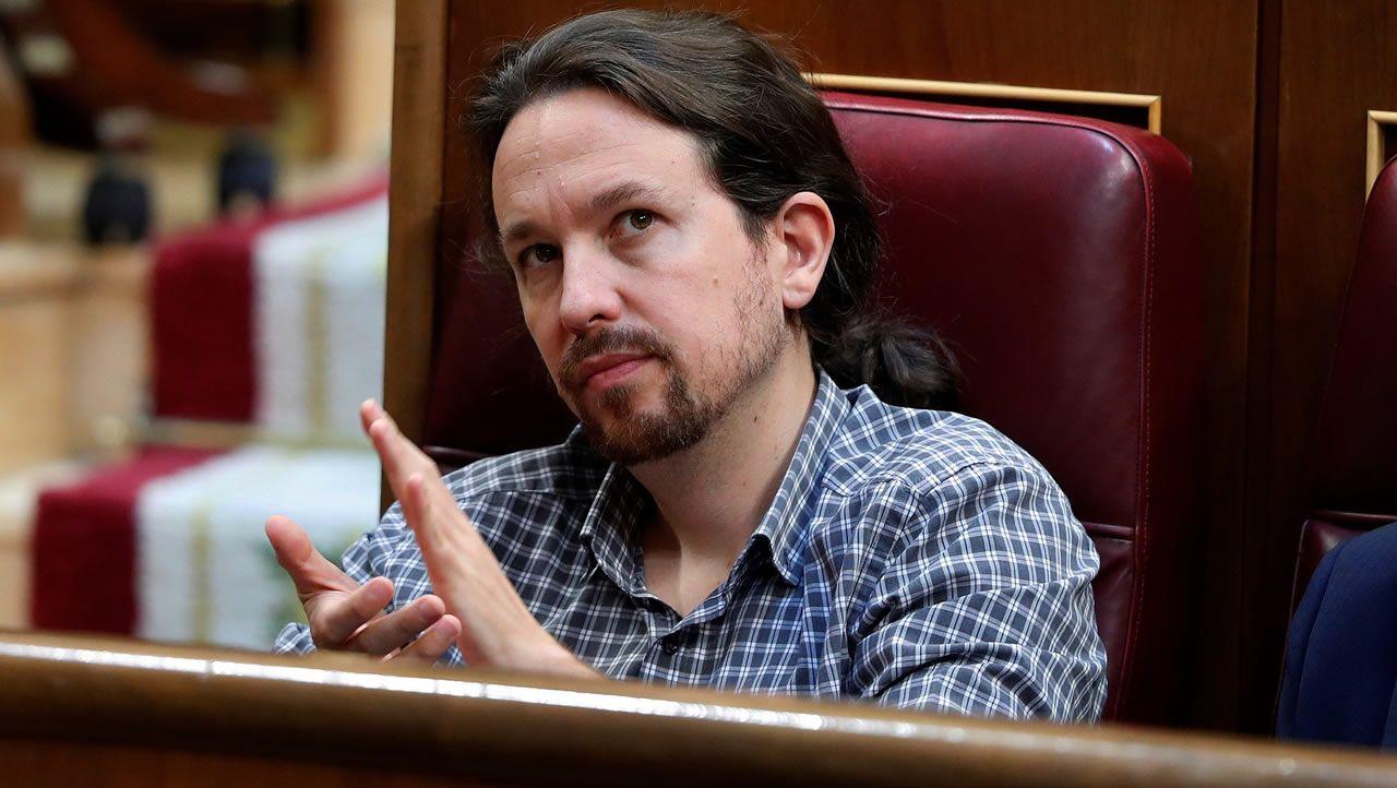 El secretario general de Unidas Podemos, Pablo Iglesias, durante el debate de investidura