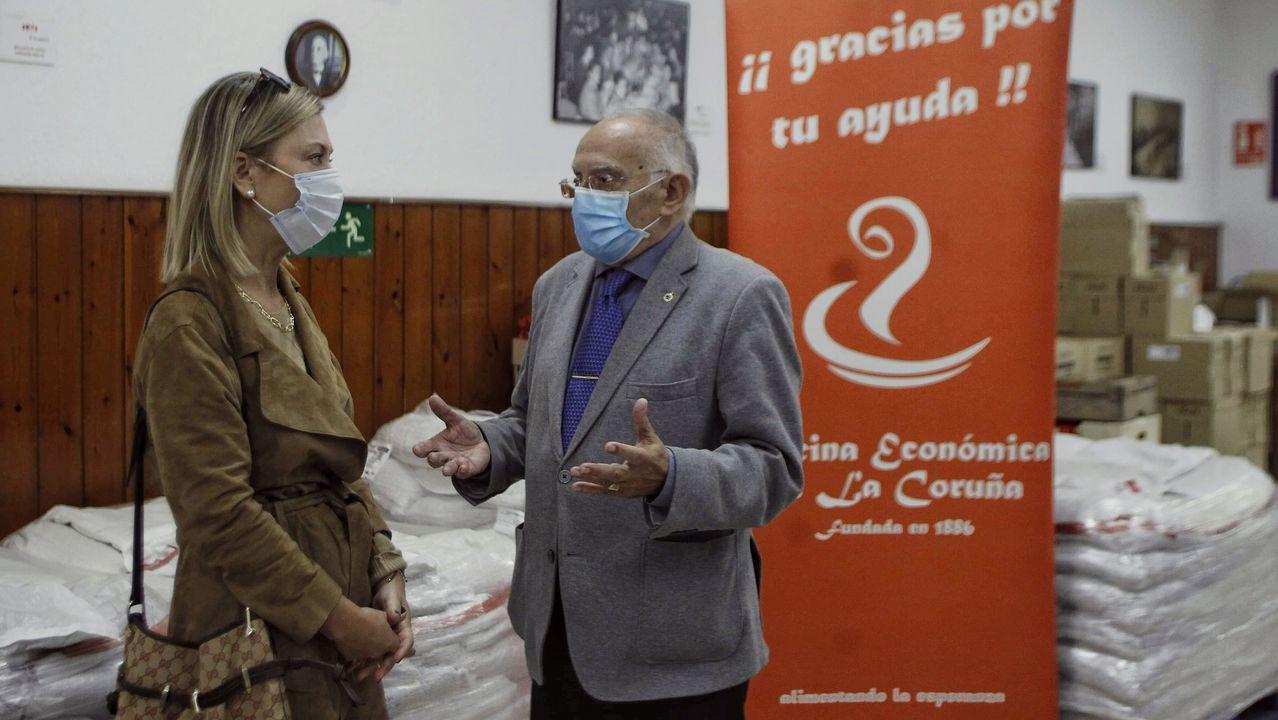 Carlos Paz, gerente territorial del Hospital Quirón, y Fernando Vidal, presidente del Deportivo