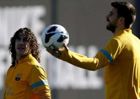 Puyol y Piqué podrían tener descanso ante el Sevilla.