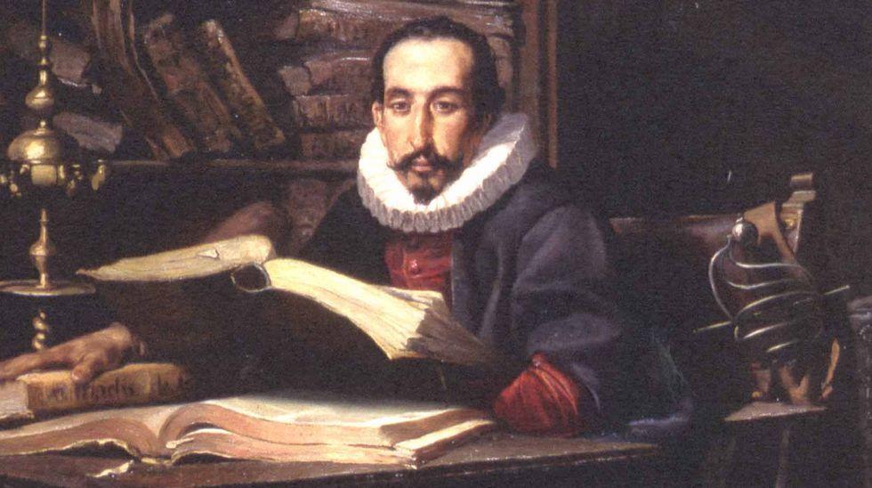 En la imagen, Antonio Seijas en el café Sevilla, junto a uno de sus lienzos