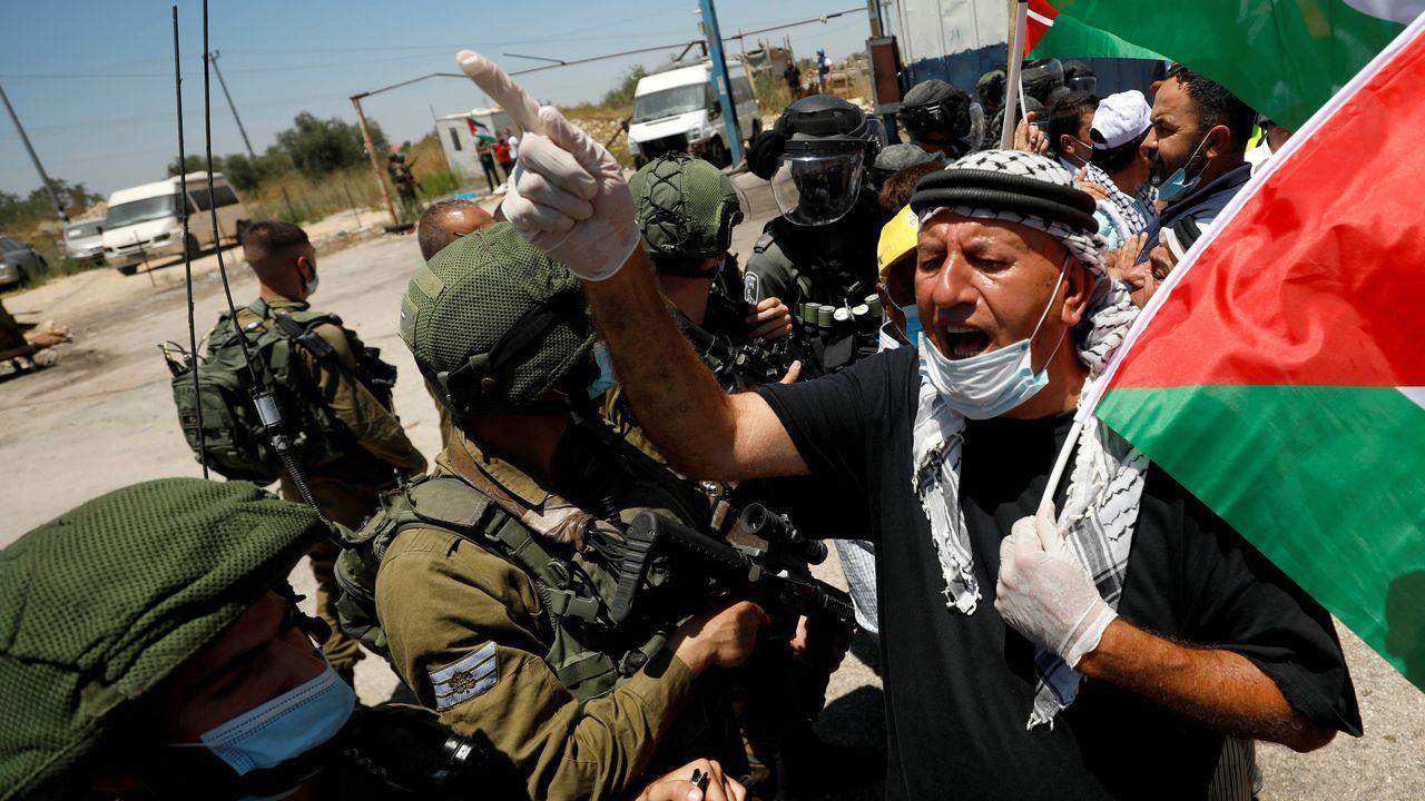 Imágenes de la pandemia en el mundo.Protesta palestina contra la anexión de parte de Cisjordania