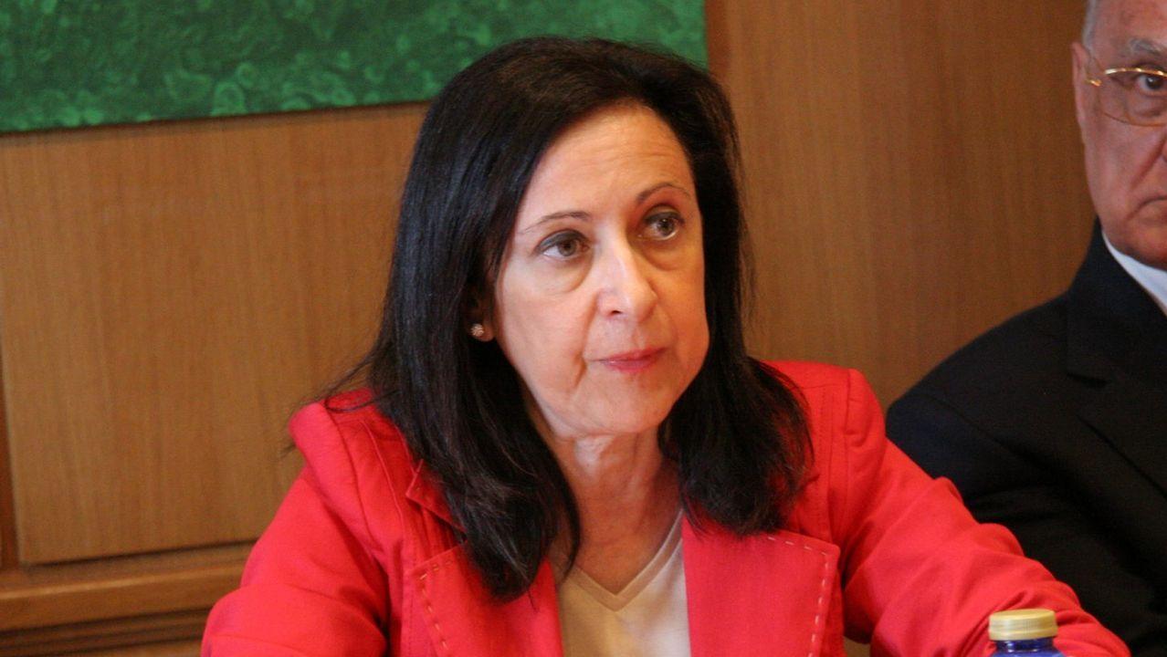 Margarita Robles.El ministro de Economía, Luis de Guindos