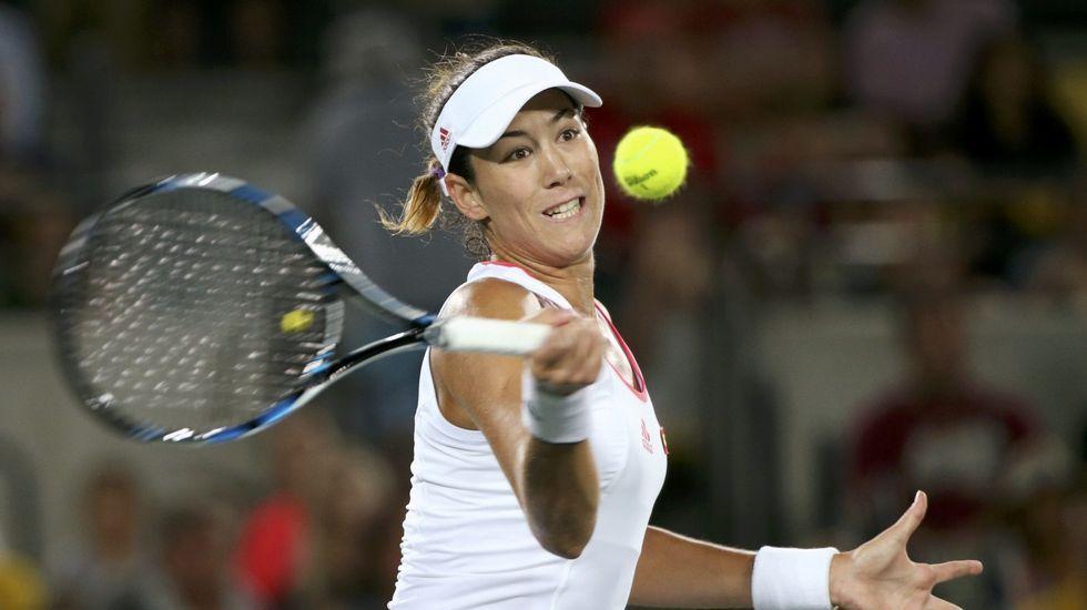 Muguruza formó en el doble femenino con Carla Suárez