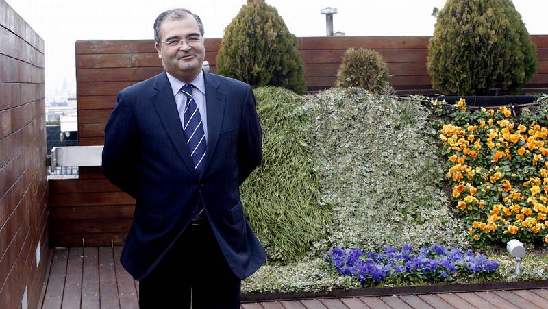 Ron (izquierda), al inicio de la presentación de las cuentas del 2012 del banco.