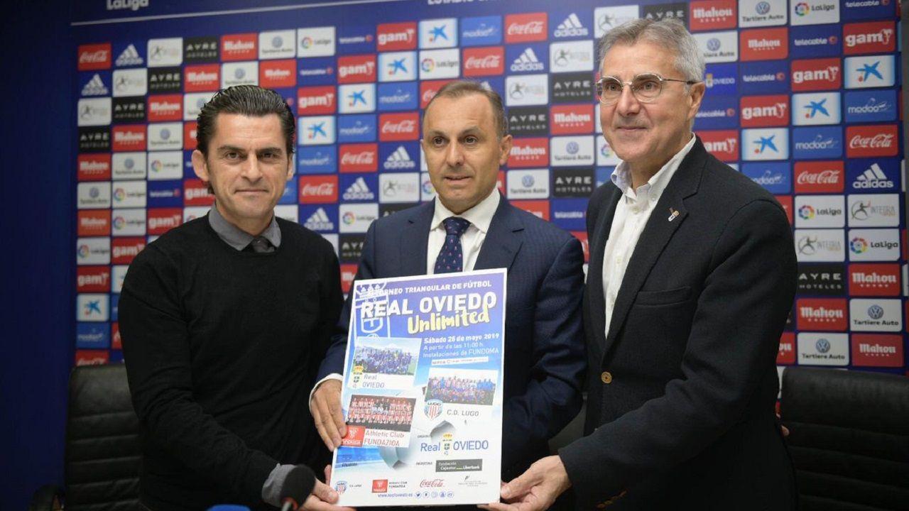 Liga Genuine Real Oviedo.Fernando Corral, en el centro, junto a los otros organizadores del torneo