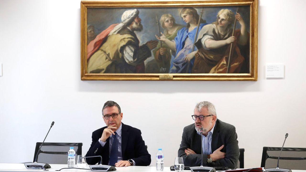 El director adjunto de conservación del museo, Andrés Úbeda (izquierda), y el director de la pinacoteca, Miguel Falomir, presentaron el programa