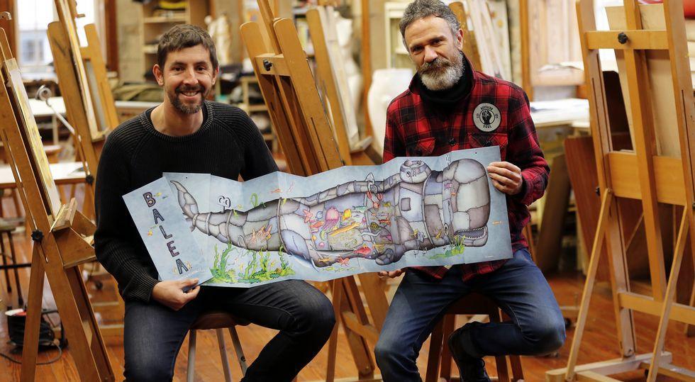 Germán González y Federico Fernández despliegan el libro en la Emao, donde el segundo da clase de dibujo.