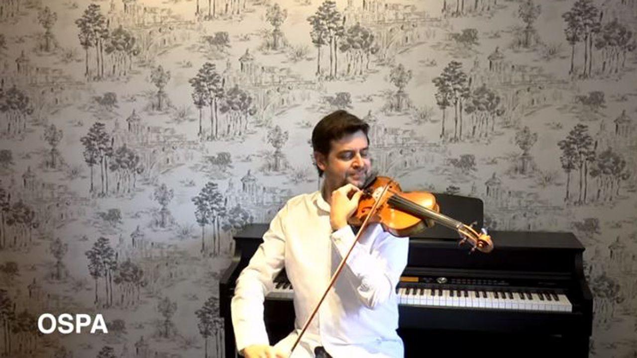 La melodía del encierro a cargo de un violinista de la OSPA.Imagen de archivo del tercer torneo Primavera del Pabellón.