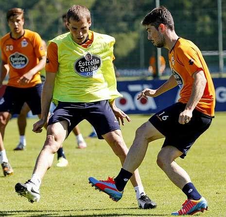 Bergantiños con Luisinho, en un entrenamiento.