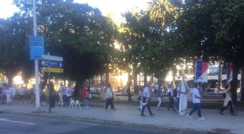 Marcha en el centro de A Coruña por el asesinato de Diego Bello.Uno de los detenidos, conducido por agentes de la Guardia Civil y la Policía Nacional