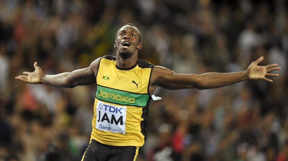 El nuevo «dress-code» de los deportistas.Bolt, a la derecha, durante la semifinal del campeonato jamaicano