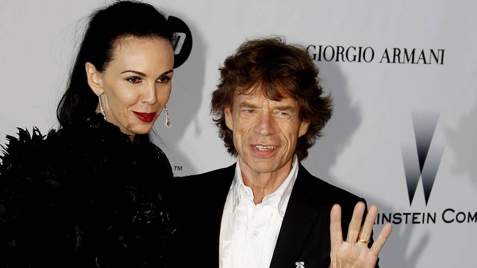 L'Wren Scott y Mick Jagger a su llegada a la gala de cine contra el sida como parte del Festival de Cine de Cannes el 20 de mayo del 2010